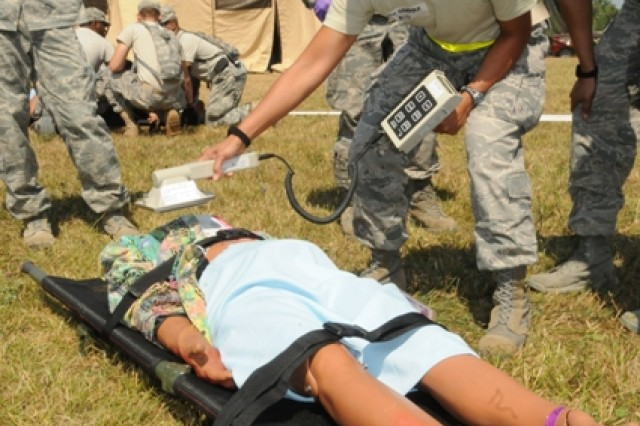 Maj. Elisa Hammer scans patients for radiological contamination during exercise Vibrant Response at Camp Atterbury Joint Maneuver Training Center, Ind., July 30, 2012.