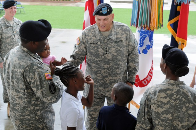 Chief of Staff of the Army Gen. Raymond T. Odierno visits with the Smith family after he reenlisted Staff Sgt. Lakeisha L. Smith and 29 other Dog Face Soldiers from the 3rd Infantry Division at Fort Stewart, Ga., Aug. 6, 2012, during his first trip to the home of the Marne Division since being sworn in as the 38th Chief of Staff of the Army on Sept. 7, 2011.