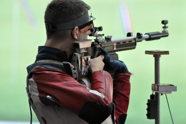 Four-time Olympian U.S. Army Marksmanship Unit shooter Sgt. 1st Class Jason Parker fires standing in the first round of the Olympic three-positions rifle competition, Aug. 6, 2012, at the Royal Artillery Barracks in London.