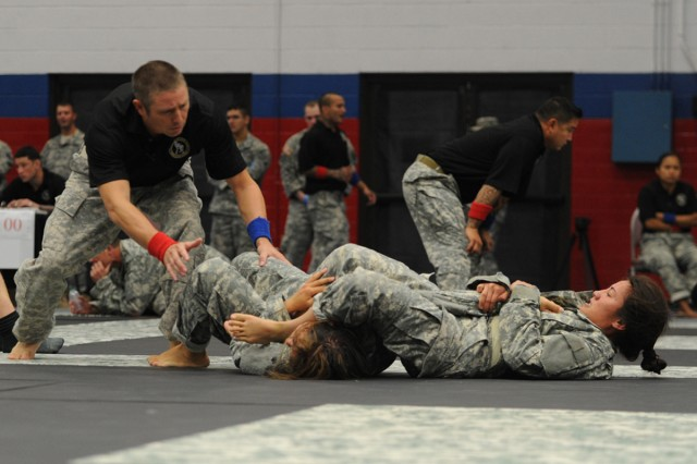 Sgt. Brandie Smithe (right) fights in the All Army Combatives Championship in the bantamweight bracket at Fort Hood, Texas.