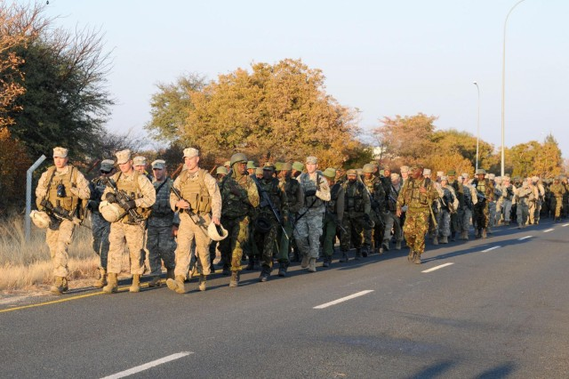 Marines, Soldiers and Botswana Defense Force conduct an early morning road march to the special forces compound to train together on Thebephatshwa Air Base in Botswana, during Southern Accord 2012. The joint military exercise brings together forces from the U.S. and BDF for Southern Accord 2012 to strengthen the tie between the partnered militaries.