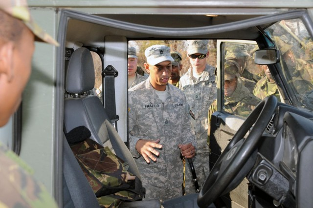 Sgt. 1st Class Donju Frazier of Maple Shade, N.J., a platoon sergeant with Company A, 1-114th Infantry Regiment, New Jersey National Guard, demonstrates the proper way to search a vehicle at a vehicle control point on Thebephatshwa Air Base in Botswana. U.S. forces are in Botswana to participate in Southern Accord 2012, an annual combined joint exercise that brings together U.S. Army personnel with BDF to enhance military capabilities and interoperability.