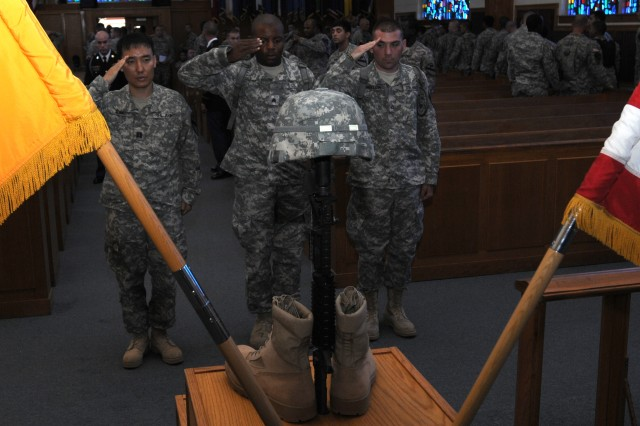 FORT HOOD, Texas--Soldiers offer a final salute to Pvt. 1st Class Joshua Holley at a memorial service held in Holley's honor here Aug. 1. Holley served with 1st Battalion, 5th Cavalry Regiment, 2nd Brigade Combat Team, 1st Cav. Div., before his death July 9, 2012.