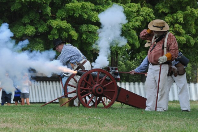 "Re-enactors fire a cannon at the ""enemy"" ship, Fair Jeanne, Saturday during the War of 1812 bicentennial weekend in Sackets Harbor."