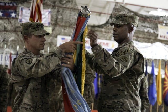 "WHEELER ARMY AIRFIELD, Hawaii "" Lt. Col Shannon-Mikal Lucas, commander 19th MP Bn. (CID) (left),and Cmd. Sgt. Maj. Henry James, senior enlisted leader, 19th MP Bn. (CID)(right), case the battalion's colors during the unit's deployment ceremony at Wheeler Gulch, here, Aug. 3, 2012. The unit will provide criminal investigative operations command in support of Operation New Dawn in Kuwait and Operation Enduring Freedom in Afghanistan."