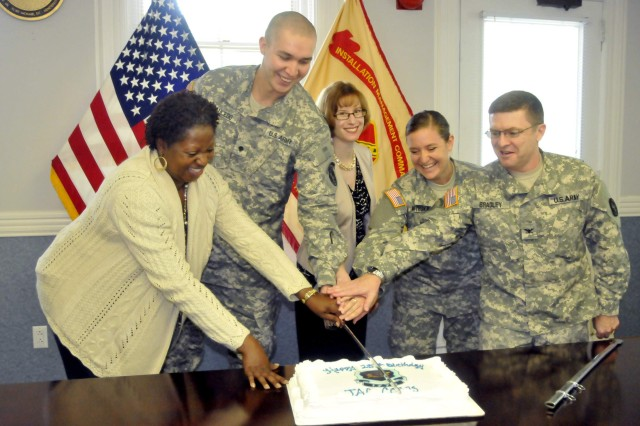 A birthday commemoration marking the 237th birthday of the Army Judge Advocate General Corps was held July 27 at Joint Base Myer-Henderson Hall's headquarters. Those honored with cutting the birthday cake are from left to right: Carolyn Autry-Sesay (longest serving in JAGC), Spc. Nicholas Saucedo (youngest enlisted member of JAGC), Allison McKay (newest civilian member of the JAGC), 1st Lt. Katherine Mitroka (newest military attorney in the JAGC) and Col. Corey Bradley, Staff Judge Advocate for the JFHQ-NCR MDW OSJA.