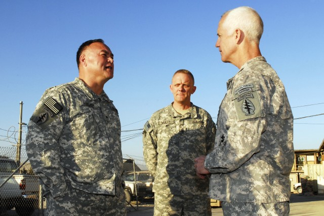 Lt. Col. Donald Lovelace and Command Sgt. Maj. David Wolff, command team for Special Operations Task Force-East, greet Brid. Gen. Edward Reeder Jr., commanding general U.S. Army Special Forces Command at Camp Montrond, Bagram, Afghanistan Jan. 23.