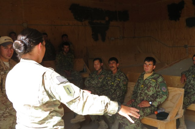 """Pfc. Michelle Shinafelt instructs soldiers of the Afghan National Army as part of a """"train-the-trainer"""" Combat Life Saver course, in Paktika Province, Afghanistan. The course trained a 19 Afghan National Army soldiers and Afghan Uniformed Police officers to lead CLS courses in their units across Paktika Province. Shinafelt, a Florida native, was the primary instructor for the course, which was led by the medics of Headquarters and Headquarters Company, 4th Brigade Special Troops Battalion, 4th infantry Brigade Combat Team, 1st Infantry Division."""