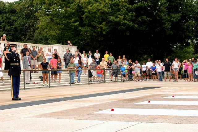 Sgt. Christopher Anthony, Tomb Sentinel, 3d U.S. Infantry Regiment (The Old Guard), salutes the crypts of the Tomb of the Unknown Soldier while Taps is played during his last walk ceremony in Arlington National Cemetery, Va., August 6, 2012. The laying of the roses signifies a Sentinel's love of the job and of the Unknowns. (U.S. Army photo by Spc. Devin Kornaus)