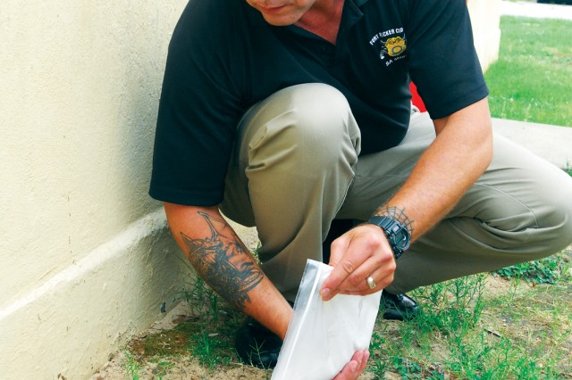 Chief Warrant Officer 4 Raymond Massey demmonstrates how to create a foot mold from a shoe impression.