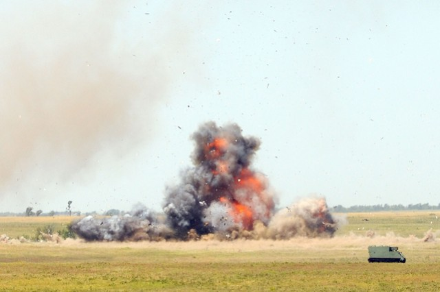 A 400-pound ammonium nitrate bomb detonates inside the back of a truck July 17 at Fort Riley's Live-Fire Trench Complex. FBI bomb technicians and Soldiers with the 162nd EOD Co., 84th EOD, 71st EOD Group, 20th Support Command-CBRNE, detonated four professionally made homemade bombs for civilian and Soldiers students in the FBI's Large Vehicle Bomb Post-Blast course.