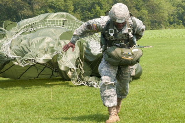 Col. Quincy Handy, 352nd Civil Affairs Command, lands a few feet past the target during Leapfest 2012 on Castle Drop Zone, West Kingston, R.I. The 10 mph wind made it difficult for paratroopers to run upwind towards the target.