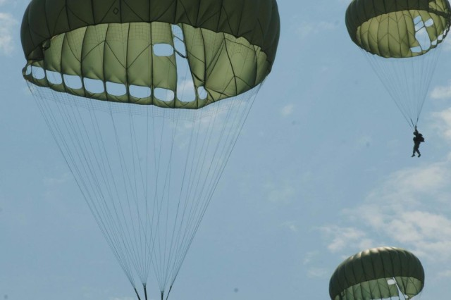 Paratroopers descends towards the target after exiting a CH-47 Chinook Helicopter at Leapfest 2012 on Castle Drop Zone, West Kingston, R.I.  Four-man teams each had to land and rush towards their target in the shortest time possible.