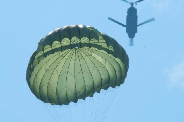 A paratrooper descends towards the target after exiting a CH-47 Chinook Helicopter at Leapfest 2012 on Castle Drop Zone, West Kingston, R.I.  Four-man teams each had to land and rush towards their target in the shortest time possible.