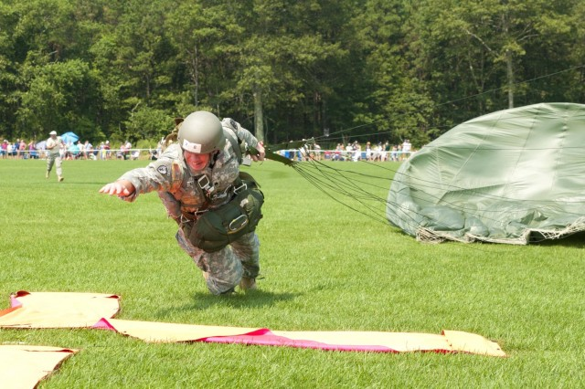 Sgt. Tellef Klemetson, Defense Logistics Agency, dives for the target during Leapfest 2012.  Over 250 paratroopers from eight different countries competed in team events.