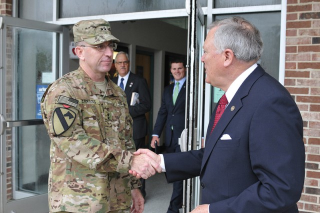 "Maj. Gen. Robert ""Abe"" Abrams, Third Infantry Division Commander thanks Georgia Governor Nathan Deal for his keynote speech after the Third Infantry Division Headquarters and Headquarters Battalion colors casing ceremony Aug. 8. (U.S. Army photo by Sgt. Uriah Walker)"