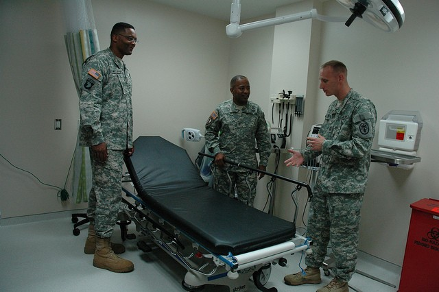 (From left) APG Garrison Commander Col. Gregory McClinton and APG and CECOM Commander Maj. Gen. Robert Ferrell listen as Clinical Nurse Officer-in-Charge Capt. Eric Mutchie gives a tour of Kirk U.S. Army Health Clinic's new Primary Care Clinic July 23.