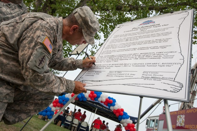 Fort George G. Meade Installation Commander, Colonel Edward C. Rothstein signs the Community National Night Out proclamation.