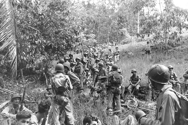 U.S. Marines rest in the field on Guadalcanal, circa August-December 1942.