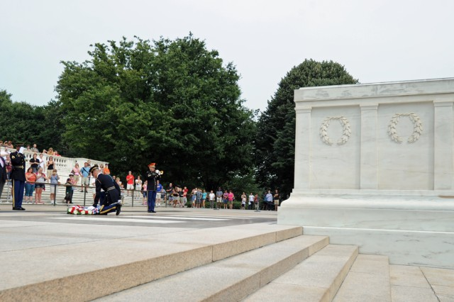 Veterans of the Guadalcanal Campaign of Aug. 7, 1942, salute as Taps is sounded after they presented a wreath at the Tomb of the Unknowns in recognition of the Marines, Soldiers, Sailors and Coast Guardsmen who served in the six-month south Pacific campaign.