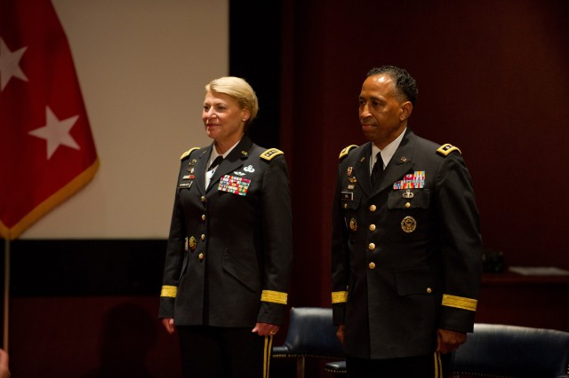 U.S. Army Gen. Ann E. Dunwoody, Commanding General Army Materiel Command, stands next to Lt. Gen. Dennis L. Via during his promotion ceremony to the rank of General at Redstone Arsenal, Ala., August 7, 2012. Via is the first Army Signal Corps officer to achieve the rank of General. (U.S. Army photo by Staff Sgt. Teddy Wade/Released)