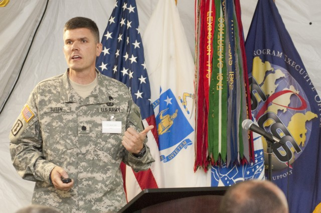 "Lt. Col. James E. Tuten, outgoing Product Manager Force Sustainment Systems at Natick Soldier Systems Center, speaks Aug. 8 during ""Operational Energy Day"" at the Army Base Camp Integration Laboratory at Fort Devens, Mass."