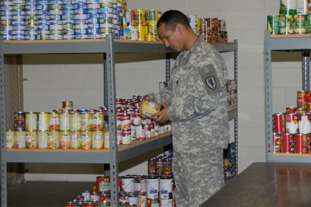 First Sgt. Argelio Rodriguez, HHC 1st Avn. Bde. first sergeant, catalogs non-perishable canned goods at the HHC 1st Avn. Bde. Food Locker Aug. 6. The Feds Feed Families Food Drive campaign is aiming to fill the food locker for Soldiers and their Families in need on Fort Rucker.