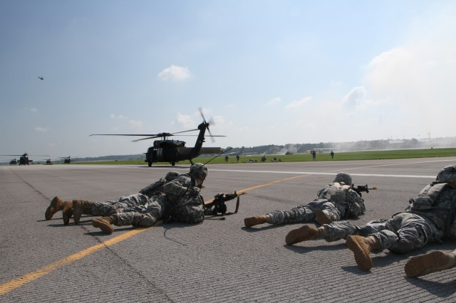 FORT CAMPBELL, Ky- Soldiers from the 2nd Battalion, 506th Infantry Regiment, 4th Brigade Combat Team, 101st Airborne Division, seconds after unloading from their UH-60 Blackhawk helicopters from the 159th Combat Aviation Brigade, 101st Abn. Div., conduct an air assault, August 7, 2012 in preparation for Week of Eagles, at Fort Campbell, Ky. (U.S. Army photo by Staff Sgt. Todd A Christopherson, 4th Brigade Combat Team Public Affairs)