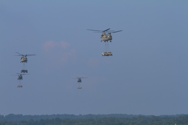 FORT CAMPBELL, Ky- U.S. Army CH-47 Chinook helicopters from the 159th Combat Aviation Brigade, 101st Airborne Division, approach to offload the Soldiers from 2nd Battalion, 506th Infantry Regiment, 4th Brigade Combat Team, 101st Abn. Div., and their sling-loaded vehicles while conducting an air assault, August 7, 2012 in preparation for the Week of Eagles, at Fort Campbell, Ky. (U.S. Army photo by Maj. Kamil Sztalkoper, 4th Brigade Combat Team Public Affairs)