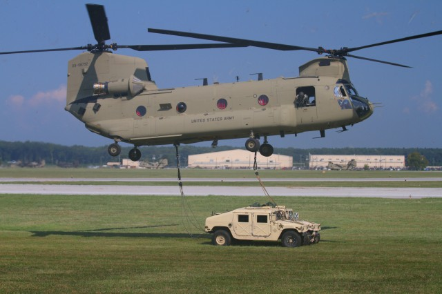 FORT CAMPBELL, Ky- U.S. Army CH-47 Chinook helicopter from the 159th Combat Aviation Brigade, 101st Airborne Division, prepares to offload the Soldiers from 2nd Battalion, 506th Infantry Regiment, 4th Brigade Combat Team, 101st Abn. Div., and their sling-loaded vehicles while conducting an air assault, August 7, 2012 in preparation for the Week of Eagles, at Fort Campbell, Ky. (U.S. Army photo by Maj. Kamil Sztalkoper, 4th Brigade Combat Team Public Affairs)