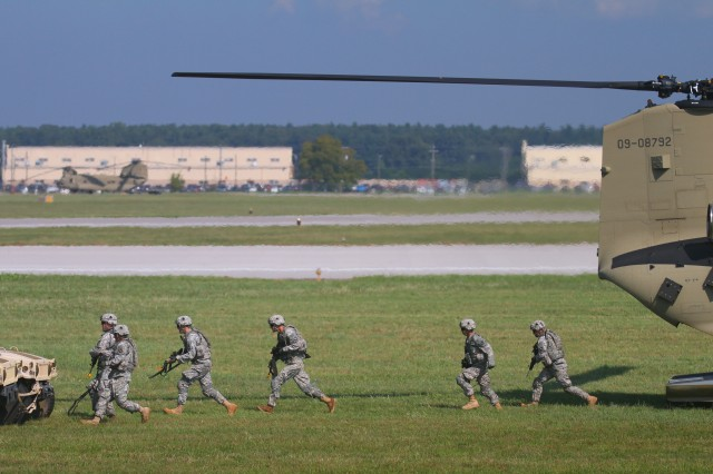 FORT CAMPBELL, Ky- Soldiers from the 2nd Battalion, 506th Infantry Regiment, 4th Brigade Combat Team, 101st Airborne Division, ran off the U.S. Army CH-47 Chinook from the 159th Combat Aviation Brigade, 101st Abn. Div., to their vehicles while conducting an air assault, August 7, 2012 in preparation for Week of Eagles, at Fort Campbell, Ky. (U.S. Army photo by Maj. Kamil Sztalkoper, 4th Brigade Combat Team Public Affairs)