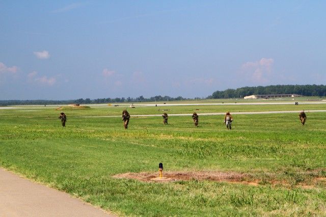 FORT CAMPBELL, Ky- Scouts from the 2nd Battalion, 506th Infantry Regiment, 4th Brigade Combat Team, 101st Airborne Division, move across the airfield after providing over watch support to the Soldiers conducting an air assault, August 7, 2012 in preparation for Week of Eagles, at Fort Campbell, Ky. (U.S. Army photo by Staff Sgt. Todd A Christopherson, 4th Brigade Combat Team Public Affairs)