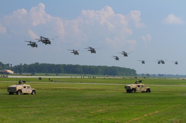 FORT CAMPBELL, Ky- U.S. Army UH-60 Blackhawk helicopters from the 159th Combat Aviation Brigade, 101st Airborne Division, fly overhead moments after delivering the Soldiers from 2nd Battalion, 506th Infantry Regiment, 4th Brigade Combat Team, 101st Abn. Div., while conducting an air assault, August 7, 2012 in preparation for the Week of Eagles, at Fort Campbell, Ky. (U.S. Army photo by Maj. Kamil Sztalkoper, 4th Brigade Combat Team Public Affairs)