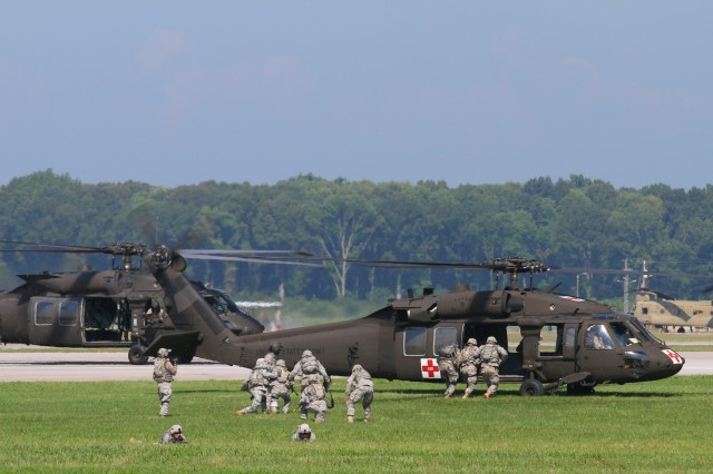 FORT CAMPBELL, Ky- Soldiers from the 2nd Battalion, 506th Infantry Regiment, 4th Brigade Combat Team, 101st Airborne Division, load the simulated casualties on the medevac UH-60 Blackhawk helicopter from the 159th Combat Aviation Brigade, 101st Abn. Div., as others provide security for them while conducting an air assault, August 7, 2012 in preparation for Week of Eagles, at Fort Campbell, Ky. (U.S. Army photo by Maj. Kamil Sztalkoper, 4th Brigade Combat Team Public Affairs)