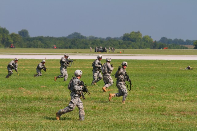 FORT CAMPBELL, Ky- Soldiers from the 2nd Battalion, 506th Infantry Regiment, 4th Brigade Combat Team, 101st Airborne Division, assault across the airfield towards their objective while conducting an air assault, August 7, 2012 in preparation for Week of Eagles, at Fort Campbell, Ky. (U.S. Army photo by Maj. Kamil Sztalkoper, 4th Brigade Combat Team Public Affairs)