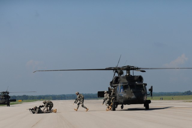 FORT CAMPBELL, Ky- Soldiers from the 2nd Battalion, 506th Infantry Regiment, 4th Brigade Combat Team, 101st Airborne Division, assualt off their UH-60 Blackhawk helicopters from the 159th Combat Aviation Brigade, 101st Abn. Div., while conducting an air assault, August 7, 2012 in preparation for Week of Eagles, at Fort Campbell, Ky. (U.S. Army photo by Staff Sgt. Todd A Christopherson, 4th Brigade Combat Team Public Affairs)