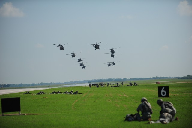 FORT CAMPBELL, Ky- U.S. Army UH-60 Blackhawk helicopters from the 159th Combat Aviation Brigade, 101st Airborne Division, fly overhead moments after delivering the Soldiers from 2nd Battalion, 506th Infantry Regiment, 4th Brigade Combat Team, 101st Abn. Div., while conducting an air assault, August 7, 2012 in preparation for the Week of Eagles, at Fort Campbell, Ky. (U.S. Army photo by Staff Sgt. Todd A Christopherson, 4th Brigade Combat Team Public Affairs)