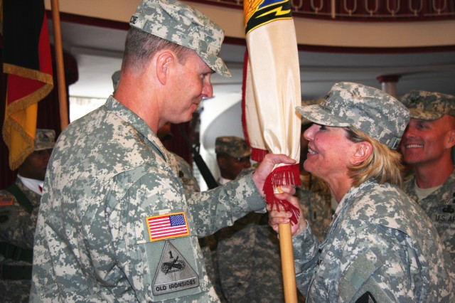 Then Maj. Gen. Patricia E. McQuistion, ASC commanding general, passes the 405th Army Field Support Brigade colors to Col. Christopher Roscoe, incoming commander, in a change of command Ceremony at Vogelweh, Germany, on July 12. McQuistion has since been promoted to rank of lieutenant general and is now the deputy commanding general of ASC's higher headquarters, Army Materiel Command. (Photo by Steven Stanfill, 405th AFSB Public Affairs)