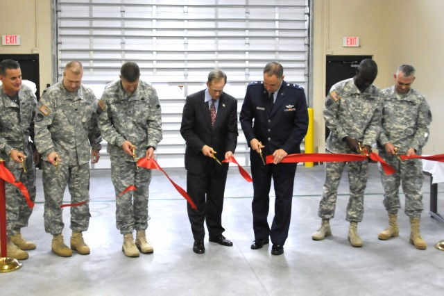 Leaders of the Georgia National Guard and Congressman Jack Kingston, 1st  Congressional District, cut the ribbon on the newly constructed Georgia National Guard Readiness Center at Hunter Army Airfield, Ga., July 31, 2012. (Left to right) Chief Warrant Officer 4 Charles Woodward, commander, 935th Aviation Support Maintenance Battalion Detachment; Col. Brock Gaston, commander, 78th Aviation Troop Command; Brig. Gen. Joseph Jarrard, commanding general, Georgia Army National Guard; Congressman Jack Kingston, Georgia 1st Congressional District representative; Maj. Gen. James Butterworth, adjutant general, Georgia National Guard; Chief Warrant Officer 4 Timothy Ladson, training officer, 1st Battalion, 169th Combat Aviation Brigade Detachment; Chief Warrant Officer 2 Anthony Brooks, commander 1st Battalion, Detachment 1, Company B, Unmanned Aerial Systems, 48th Special Troops Battalion.