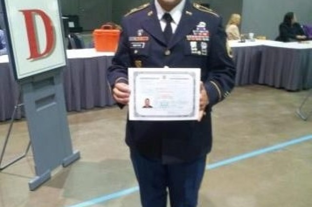 Staff Sgt. Fabrizio Bustos poses with a certificate of citizenship during a mass naturalization ceremony June 27 at the Los Angeles Convention Center.  Bustos and fellow 11th Armored Cavalry Regiment Soldier Spc. Rami Assaf became U.S. citizens during the ceremony.