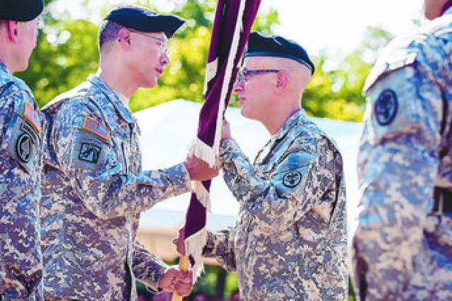 Brig. Gen. Joseph Caravalho Jr., commanding general of the U.S. Army Medical Command's Northern Regional Medical Command, passes the guidon to Col. Danny B.N. Jaghab, incoming commander of U.S. Army Medical Activity, Fort Meade, and Kimbrough Ambulatory Care Center. (Photo by Nate Pesce)