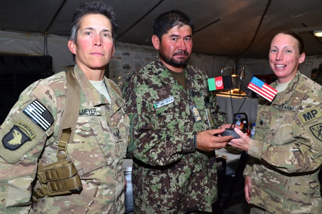 "CAMP SABALU-HARRISON, Afghanistan""Members of the Afghan National Army Detention Operations Command attended an Iftar dinner here, hosted by Task Force Protector, August 6, 2012. The Iftar was a show of support by Task Force Protector for their Afghan counterpart as they observe Ramazan. Iftar is the evening meal when Muslims break their fast during the Islamic month of Ramazan. In attendance was, ANA Maj. Gen. Ghulam Farouq, detention operations commander, and U.S. Army Col. Robert M. Taradash, commander, Task Force Protector. Each member of the Task Force Protector staff partner with the ANA Military Police Brigade in Parwan for the smooth and safe transition of the Detention Facility in Parwan. In this photo from the left Command Sgt. Maj. Dawn Rippelmeyer, senior enlisted advisor to the commander, Task Force Protector, ANA Command Sgt. Maj. Hannif, senior enlisted advisor to the commander, Military Police Brigade Parwan, and Lt. Col. Niave Knell, deputy commander, Task Force Protector."