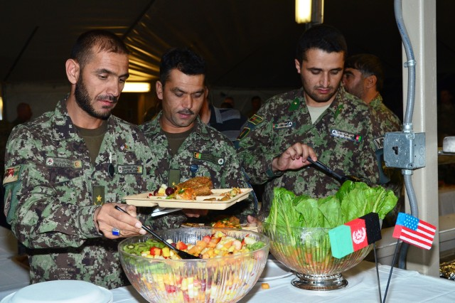 "CAMP SABALU-HARRISON, Afghanistan""Members of the Afghan National Army Detention Operations Command attended an Iftar dinner here, hosted by Task Force Protector, August 6, 2012. The Iftar was a show of support by Task Force Protector for their Afghan counterpart as they observe Ramazan. Iftar is the evening meal when Muslims break their fast during the Islamic month of Ramazan. In attendance was, ANA Maj. Gen. Ghulam Farouq, detention operations commander, and U.S. Army Col. Robert M. Taradash, commander, Task Force Protector. Each member of the Task Force Protector staff partners with the ANA Military Police Brigade in Parwan for the smooth and safe transition of the Detention Facility in Parwan. ""Events like this dinner close the gaps and create strong friendships,"" said Farouq."
