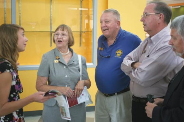 Danielle Baer (left), 13, 8th grader at Colonel Smith Middle School, leads (from left) Sierra Vista Mayor Pro Tem Carol Dockter; and Sierra Vista Councilmen Bob Blanchard, Thomas Reardon and Larry Hampton on a tour of the new school.
