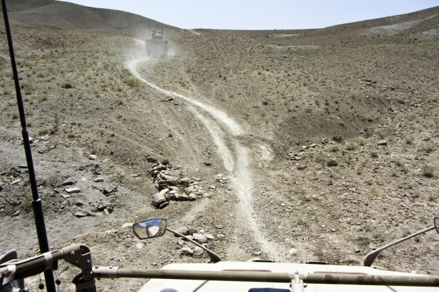 A view of the way ahead, taken from the gunner's turret on an M-ATV, shows the difficult terrain that the column had to move through.  David Nishimura and Sgt. 1st Class Gary Malkin, of the 565th Engineer Detachment (FEST-A), conducted a route reconnaissance mission in Shah Wali Kot district, Kandahar province, Afghanistan, on July 26.  (USACE photo, Sgt 1st Class Gary Malkin)