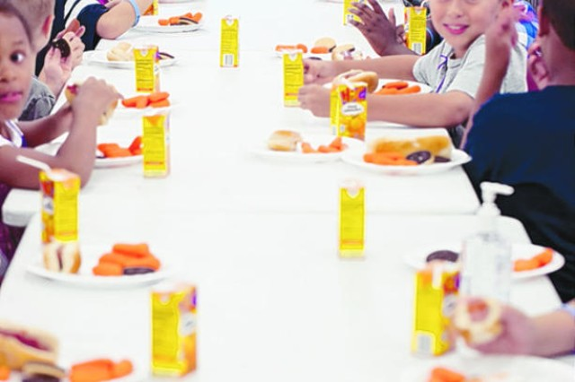 Children eat lunch in the cafeteria area during this week's Sky Vacation Bible School. More than 190 children and 90 volunteers are participating in the ecumenical program that focuses on a different theme each year.
