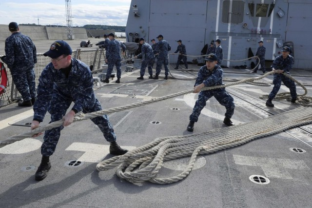 Sailors aboard the guided-missile destroyer USS Farragut (DDG 99) handle a mooring line during a sea and anchor detail while departing Tallinn. Farragut is on a scheduled deployment in support of maritime security operations and theater security cooperation efforts in the U.S. 6th Fleet area of responsibility. (Photo by Mass Communication Specialist 3rd Class A.J. Jones)