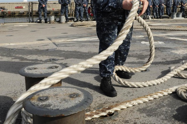 Electronics Technician 2nd Class Michael Loftus removes a mooring line on the flight deck of the guided-missile destroyer USS Farragut (DDG 99) during a sea and anchor detail as the ship departs Tallinn. Farragut is on a scheduled deployment in support of maritime security operations and theater security cooperation efforts in the U.S. 6th Fleet area of responsibility. (Photo by Mass Communication Specialist 3rd Class A.J. Jones)