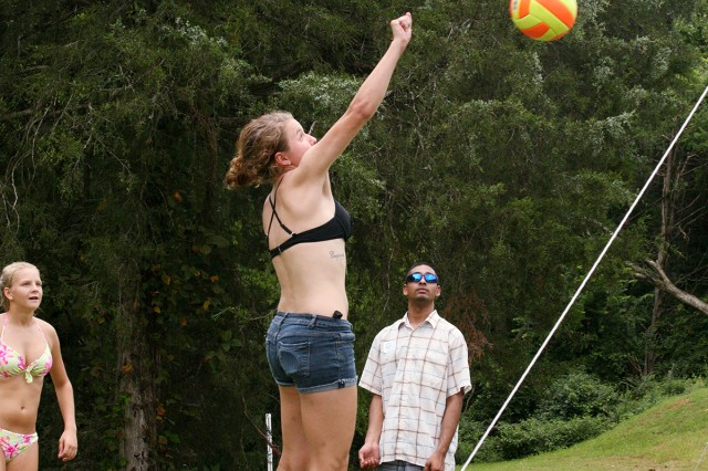 Kaitlyn Branson, 20, a survivor, goes for the volleyball during a friendly game during the Survivor Outreach Services summer bash at the Family Morale, Welfare and Recreation building Aug. 4.