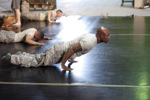 "Sgt. Andre Patterson, a resident of Swissvale, Pa., and member of the 316th Sustainment Command (Expeditionary), participates in some warm-up exercises while attending Modern Army Combatives Program Level One training at Camp Arifjan, Kuwait, Aug. 6-10. ""I wrestled in high school, I finally got a chance to get into a combatives course and I'm loving it, said Patterson."